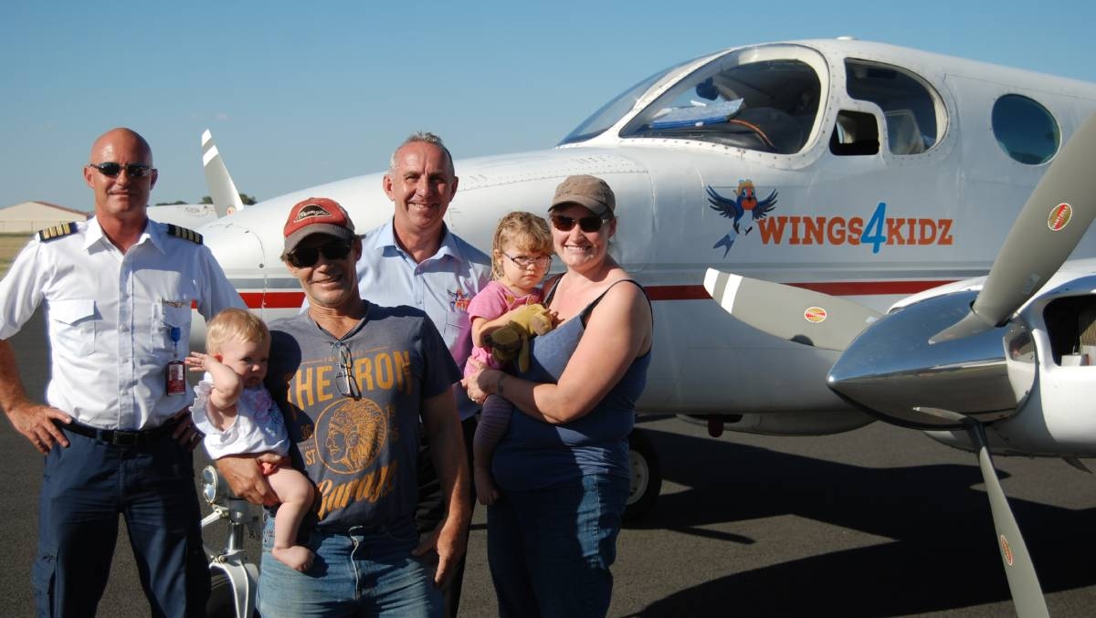 Pilot Chad Dunn with Wings4Kidz's Kevin Robinson and Esther, John, Molly and Rachel Lillyman.